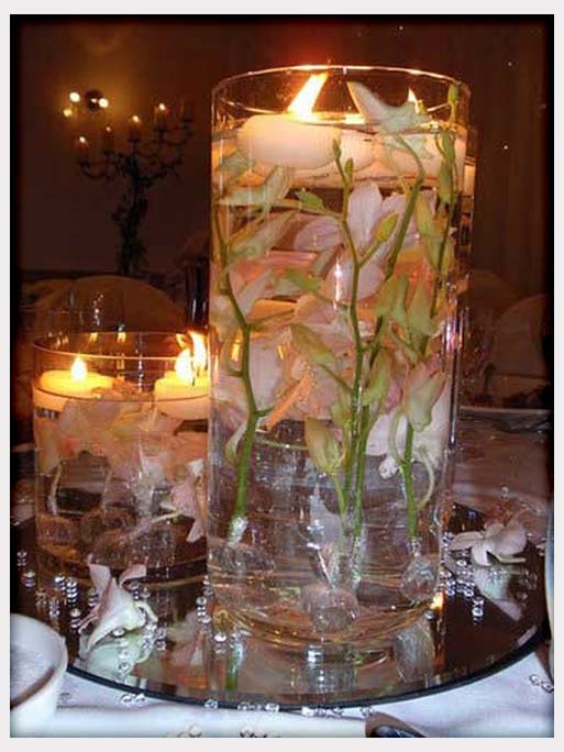 Center pieces candles flowers feathers whimsical trees weddings